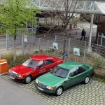 Mercedes-Benz-190-W-201-model-experimental-vehicle-with-electric-drive.-Red-1991-vehicle.-Green-vehicle-with-ZEBRA-battery-1993.
