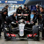 Lotus Formula One racing driver Pastor Maldonado of Venezuela sits in his car as he is pushed by members of his team during pre-season testing at the Jerez racetrack in southern Spain February 3, 2015. REUTERS/Marcelo del Pozo (SPAIN - Tags: SPORT MOTORSPORT F1)